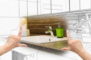 hands-poised-to-envision-future-bathroom-setting