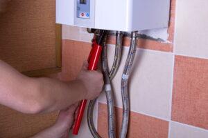 technicians-hands-working-on-water-lines